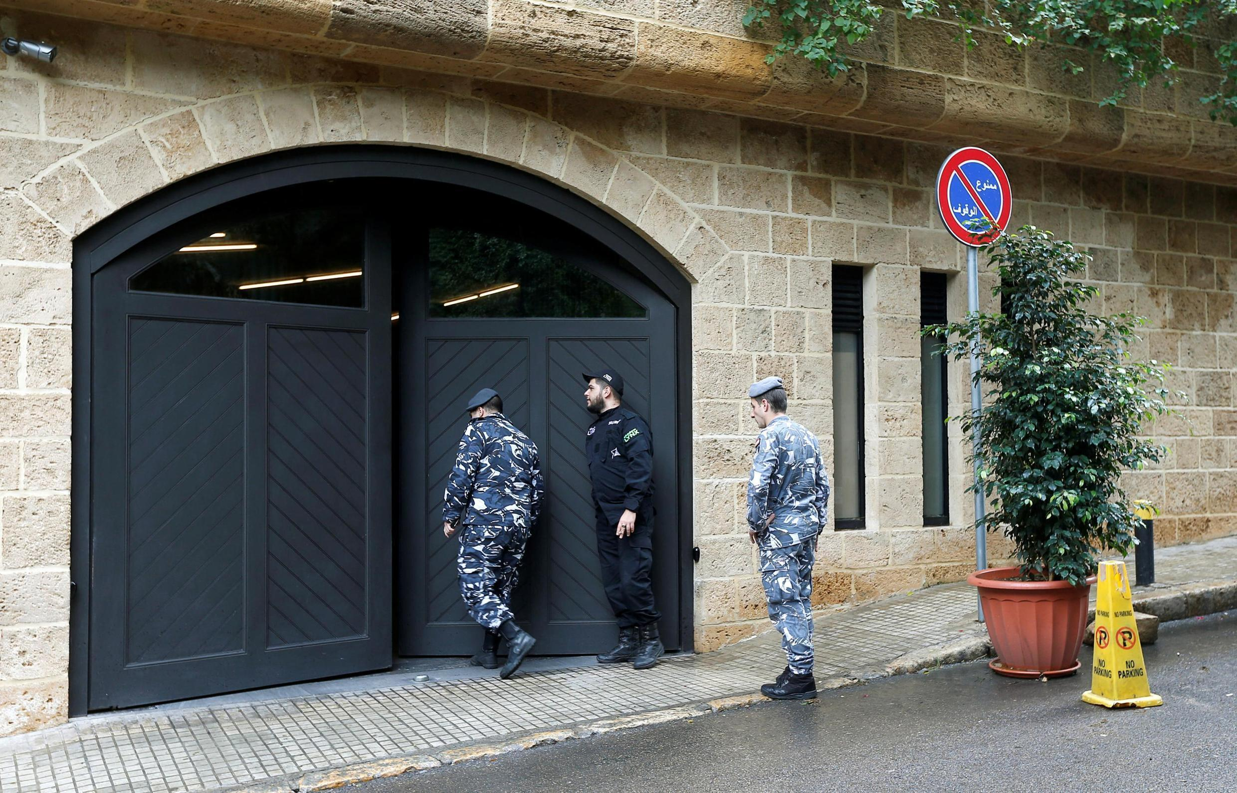 Lebanese police officers are seen at the entrance to the garage of what is believed to be former Nissan boss Carlos Ghosn's house in Beirut, Lebanon December 31, 2019.