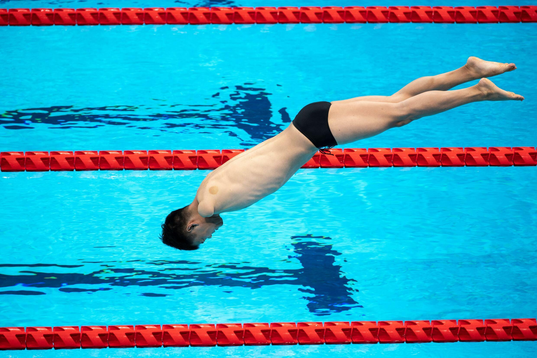 Un nageur lors d'un entraînement avant les Jeux paralympiques, le 23 août 2021 à Tokyo