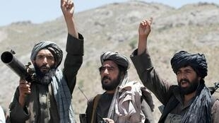 Taliban fighters celebrate after an attack on Afghan soldiers.