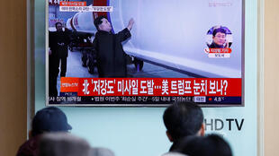 South Koreans watch a report of North Korea's missile launch