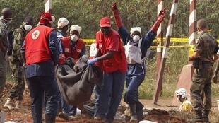 Red Cross employees bury victims of violence in Bangui on Monday