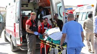 Vítimas do atentado com caminhão-bomba no centro de Mogadíscio, o mais mortal na história da Somália, que deixou mais de 250 mortos