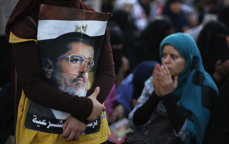 Des partisans de Mohamed Morsi, le 12 juillet 2013 au Caire.