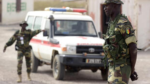 A Senegalese soldier stands next to a car as he takes part in a military exercise.