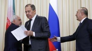 Слева направо: главы МИД Ирана, России и Турции после переговоров в Москве 20 декабря 2016 г.