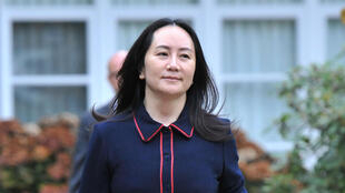 In this file photo taken on October 27, 2020, Huawei executive Meng Wanzhou leaves her Vancouver home to appear in court in Vancouver, British Columbia, Canada