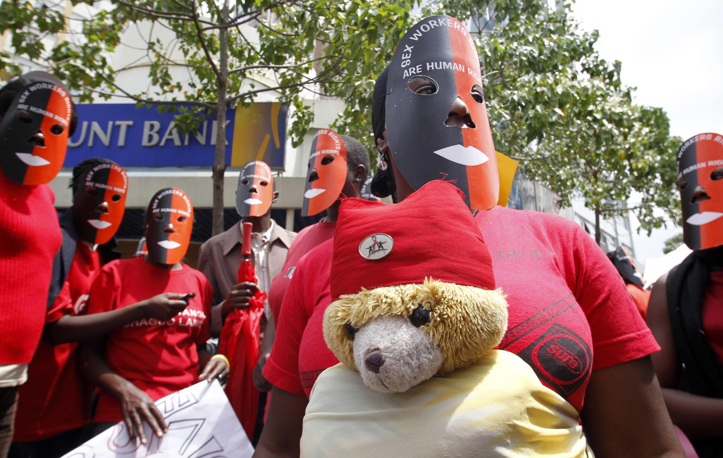 Sex workers wear masks as they participate in a demonstration along the streets of Kenya's capital Nairobi