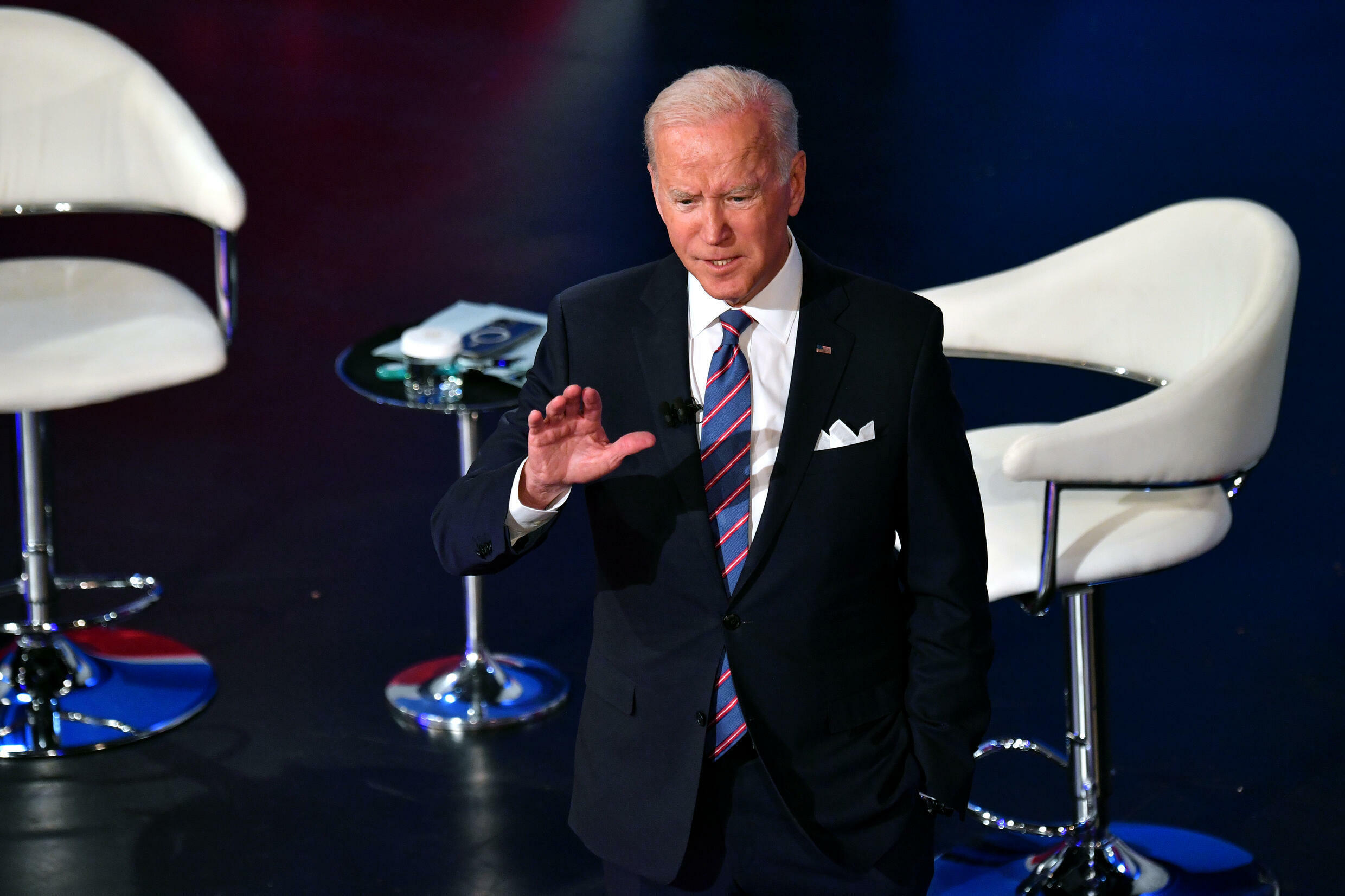 US President Joe Biden says his investment bills should pass but he appears to drop a demand for higher taxes on the richest Americans