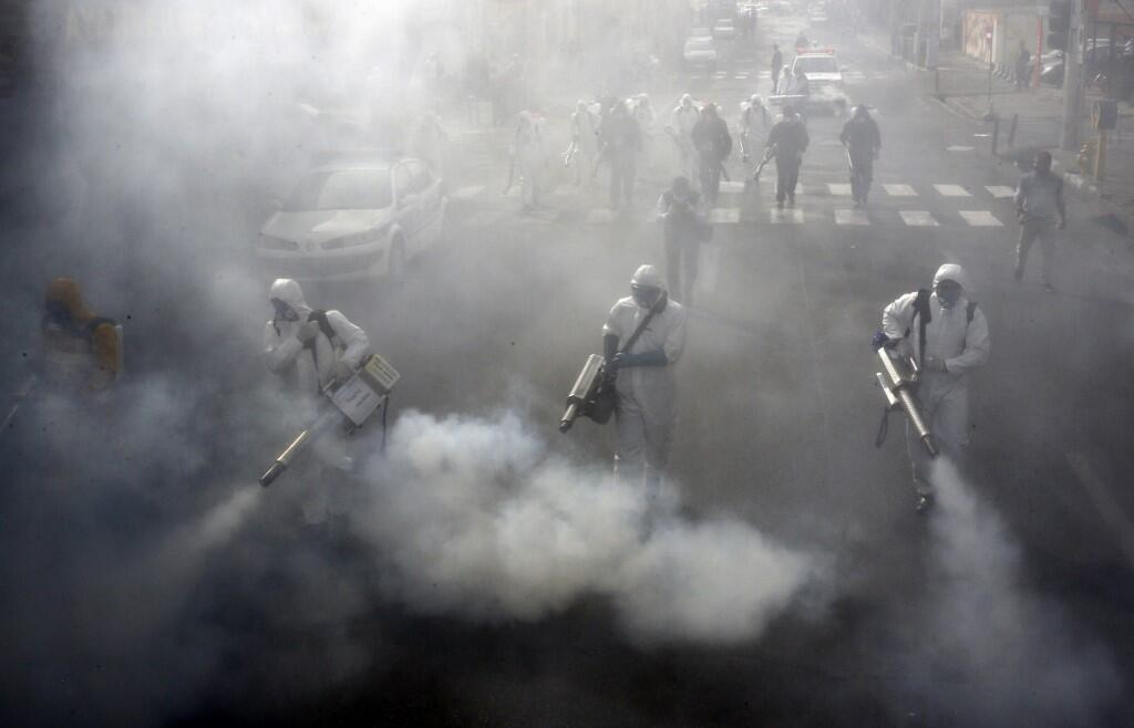 Iranian Revolutionary Guard Corps troops help with cleansing the streets of Tehran.