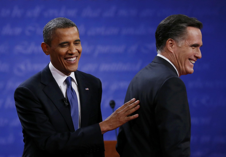 Кандидаты Барак Обама и Митт Ромни по окончании первых президентских дебатов в Денвере 03/10/2012
