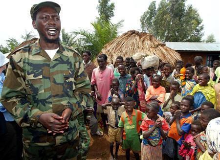 Thomas Lubanga, leader of Congo's UPC rebel group talks to villagers in 2003