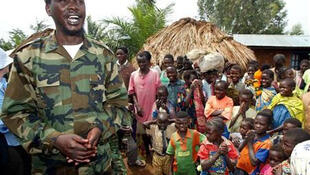 Thomas Lubanga, leader of Congo's UPC rebel group talks to villagers in 2003