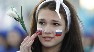 Crimea, Simferopol: A young woman at the one-year anniversary celebration of the referendum on March 16, 2015
