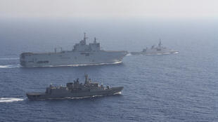 Greek and French vessels sail in formation during a joint military exercise in Mediterranean sea.