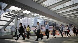 Hồng Kông : Công nhân viên chức đi làm bình thường trở lại. Ảnh sáng ngày 06/10/2014