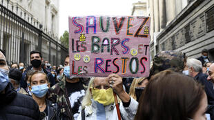 "A protester with a sign that reads ""Save bars and restaurants"" during a demonstration in Marseille, southern France, on Friday."