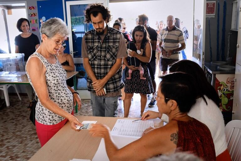 Voters cast their ballots for or against the independence of New Caledonia, November 4, 2018 in Noumea, New Caledonia.