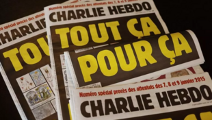 """This picture taken on September 1, 2020 in Paris shows covers of French satirical weekly Charlie Hebdo reading """"All of this, just for that,"""" to be published on September 2 to mark this week's start of the trial for 14 accused in January 2015 jihadist attacks in Paris."""