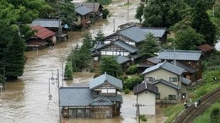 An aerial view shows a flooded residential area due to record rainfall in Tadami town, Fukushima prefecture