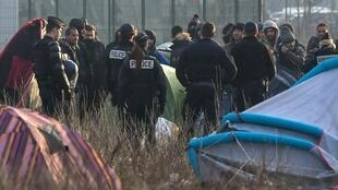 A migrant camp is evacuated by police forces on February 21, 2019 in Calais.