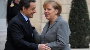 Merkozy in action - Nicolas Sarkozy and Angela Merkel at one of many meetings at the Elysée Palace