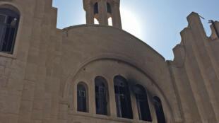 Une église de Bartella incendiée par les jihadistes.