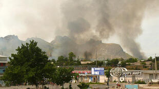 Smoke rises from the residential area of the city of Osh