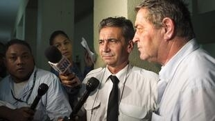 French pilots Bruno Odos (left) and Pascal Fauret after hearing their 20 year prison sentences in the Dominican Republic, 15 August 2015.
