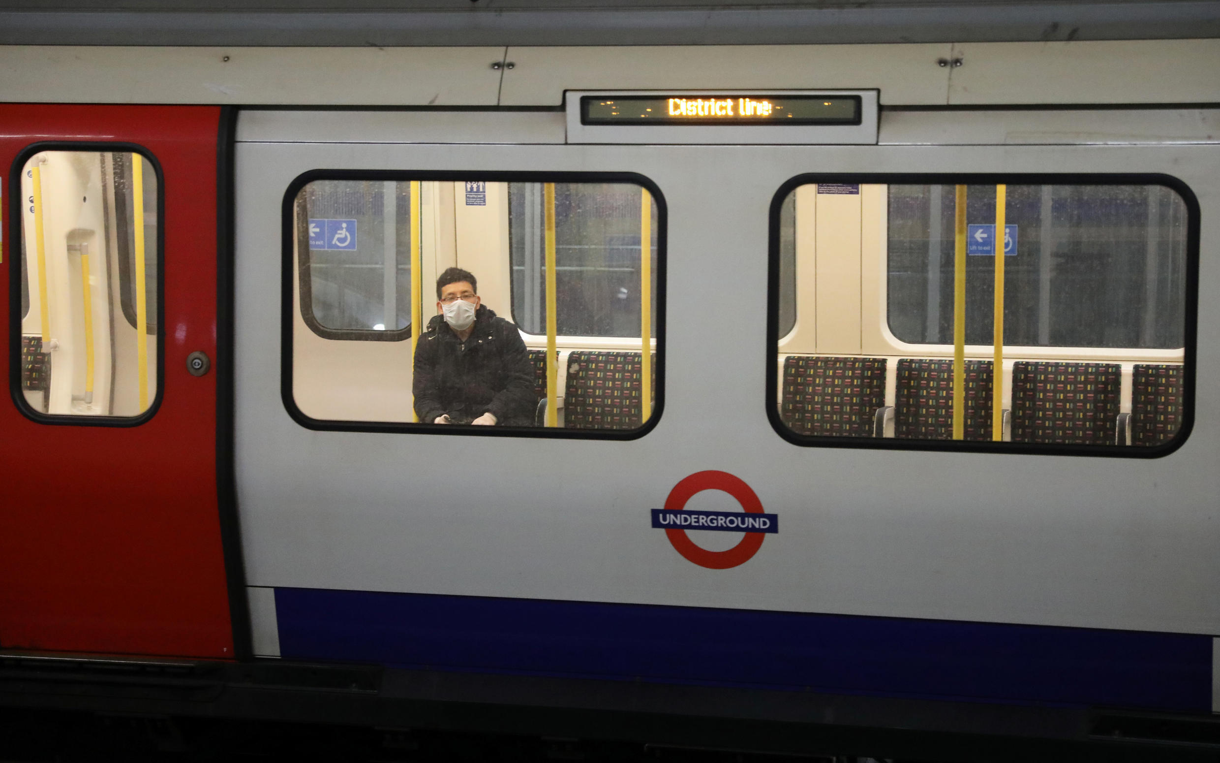 A man wearing a protective face mask is seen on a train at Westminster tube station, following the outbreak of the coronavirus disease (COVID-19), London, Britain, May 11, 2020.