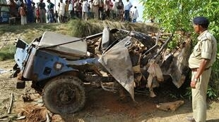 The wreckage of a security vehicle damaged in Maoist landmine blast in October