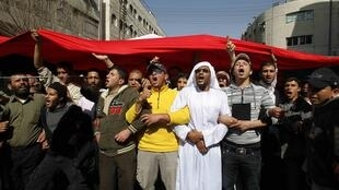 Anti-government protesters took to the streets of Amman to demand political reform on Friday.