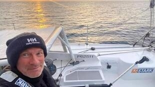Finnish Ari Huusela skipper enjoys the sunset on the eve of finishing the Vendee Globe race, 4 March 2021. He finished last after 116 days at sea.