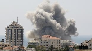 Smoke from what witnesses said was an Israeli air strike in Gaza City on Sunday