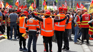This file photo shows striking French SNCF railway employees and labour union members at a demonstration in Lyon on June 12, 2018.
