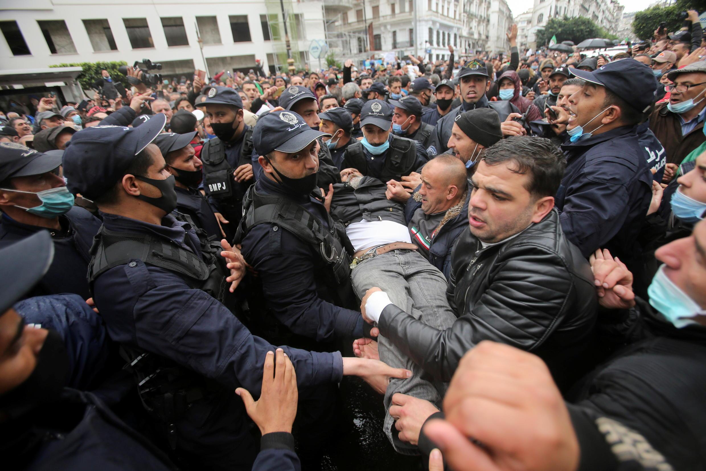 2021-02-22T112928Z_564483251_RC2NXL9VNIAE_RTRMADP_3_ALGERIA-PROTESTS-ANNIVERSARY