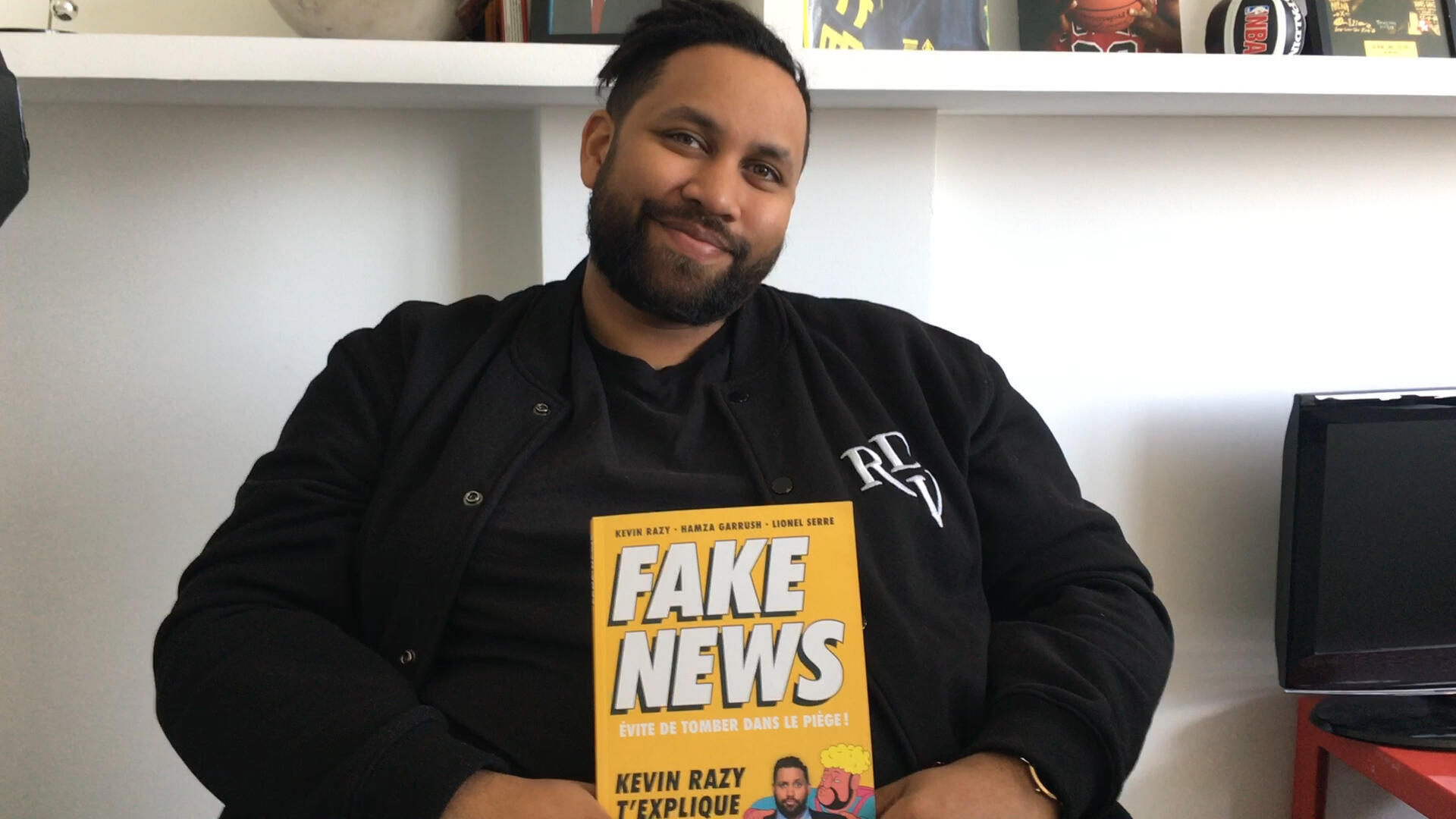 French comedian and television host Kevin Razy with his new book, Fake News: How to Avoid the Trap.