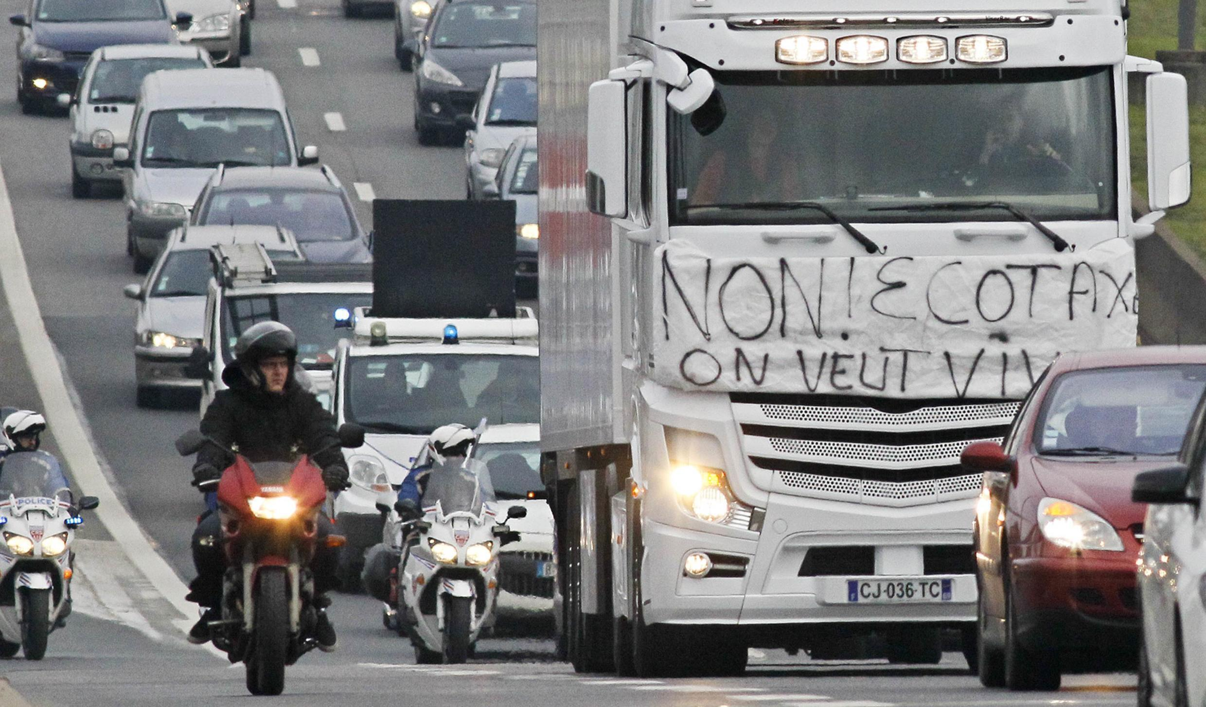 Lorries obstruct traffic near Lyon in protest at the ecotax last weekend
