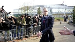 WikiLeaks founder Julian Assange leaves after appearing at Belmarsh Magistrates' Court in London 24 February 2011.