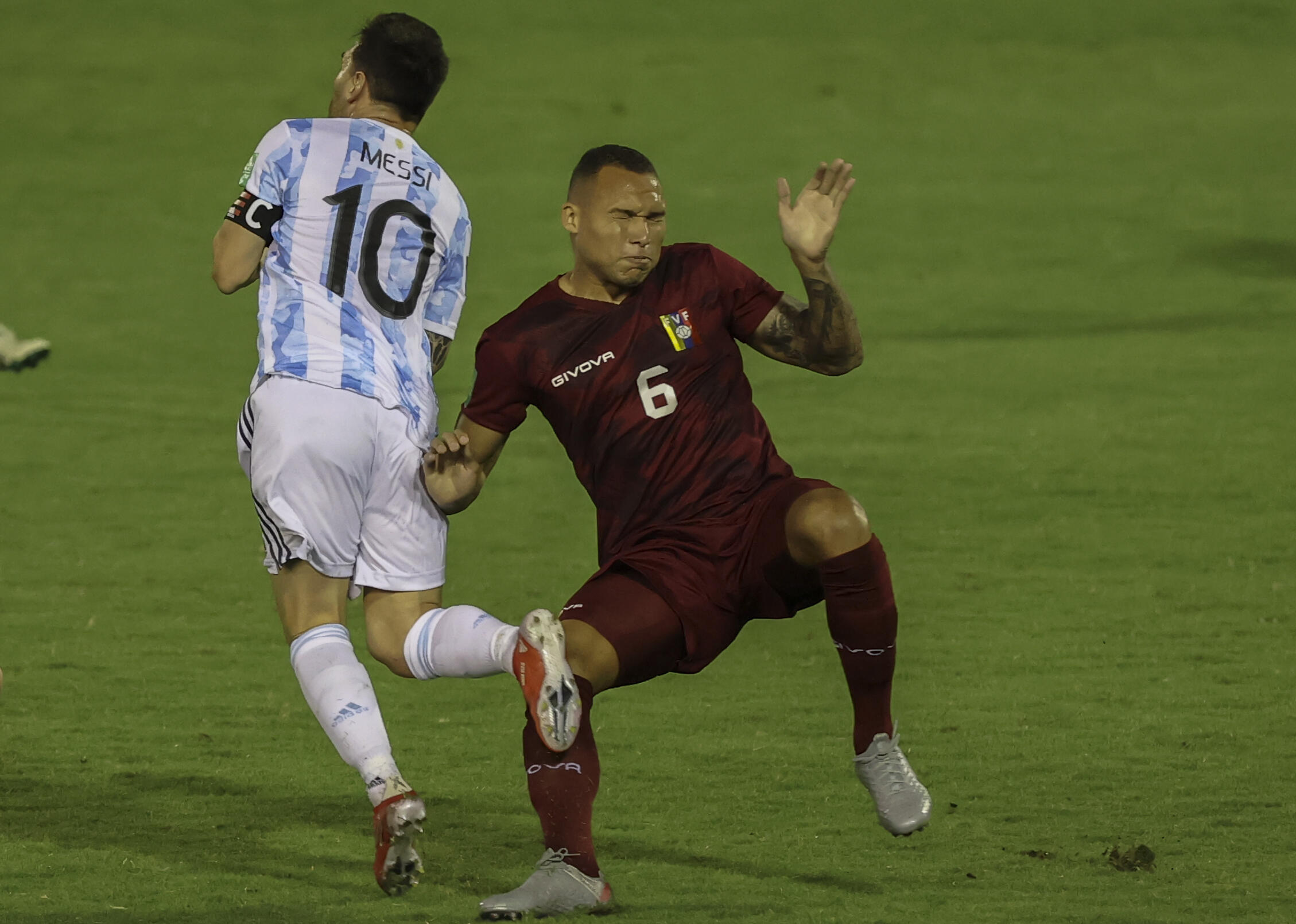 Venezuelan Luis Adrian Martinez's rash challenge on Argentina's Lionel Messi (left) earned him a straight red card