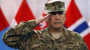 El general John Campbell, comandante de la Fuerza de  Seguridad Internacional de la OTAN en Afganistán, durante una ceremonia en Kabul, el 28 de diciembre de 2014.