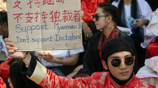 Model, actor and singer Paing Takhon at a demonstration against the Myanmar military coup in front of the Chinese embassy in Yangon on February 11, 2021