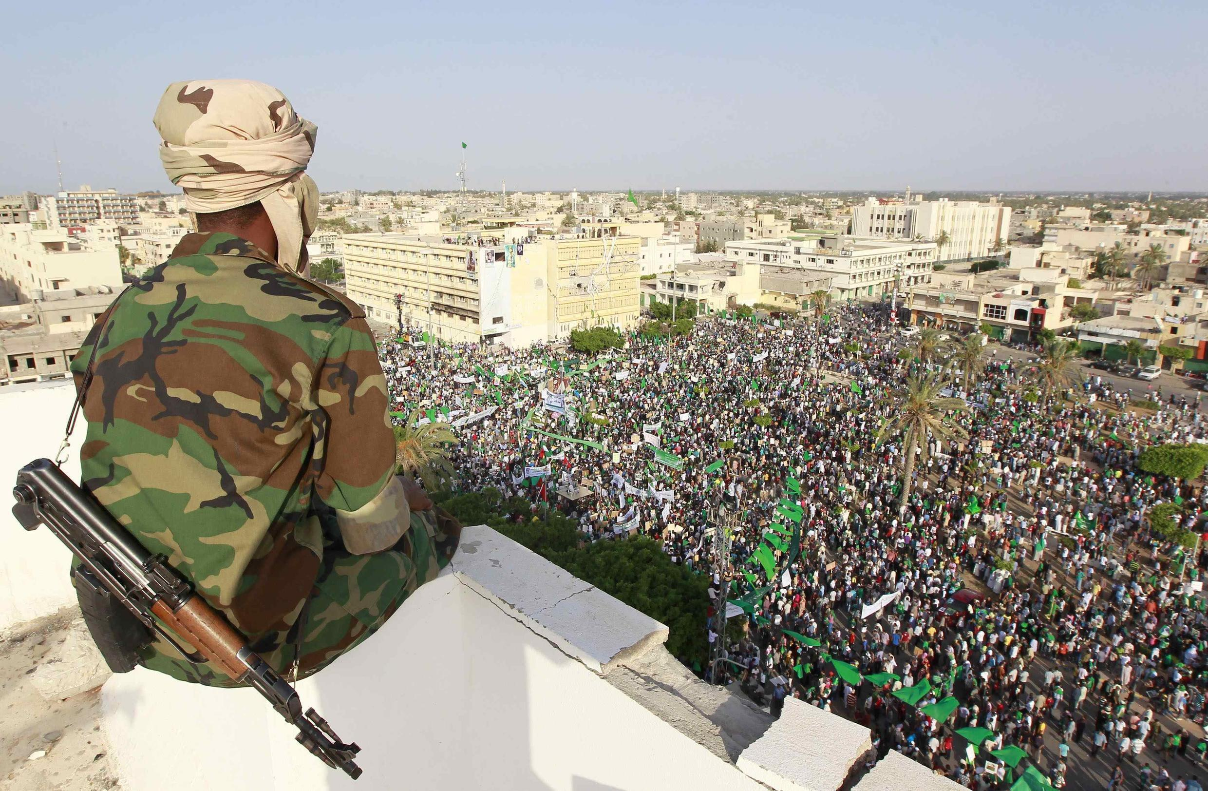 Kadhafi tells supporters in Zawiyah he will never leave his ancestor's land