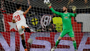 Manchester United's David De Gea makes a save from Sevilla's Luis Muriel.