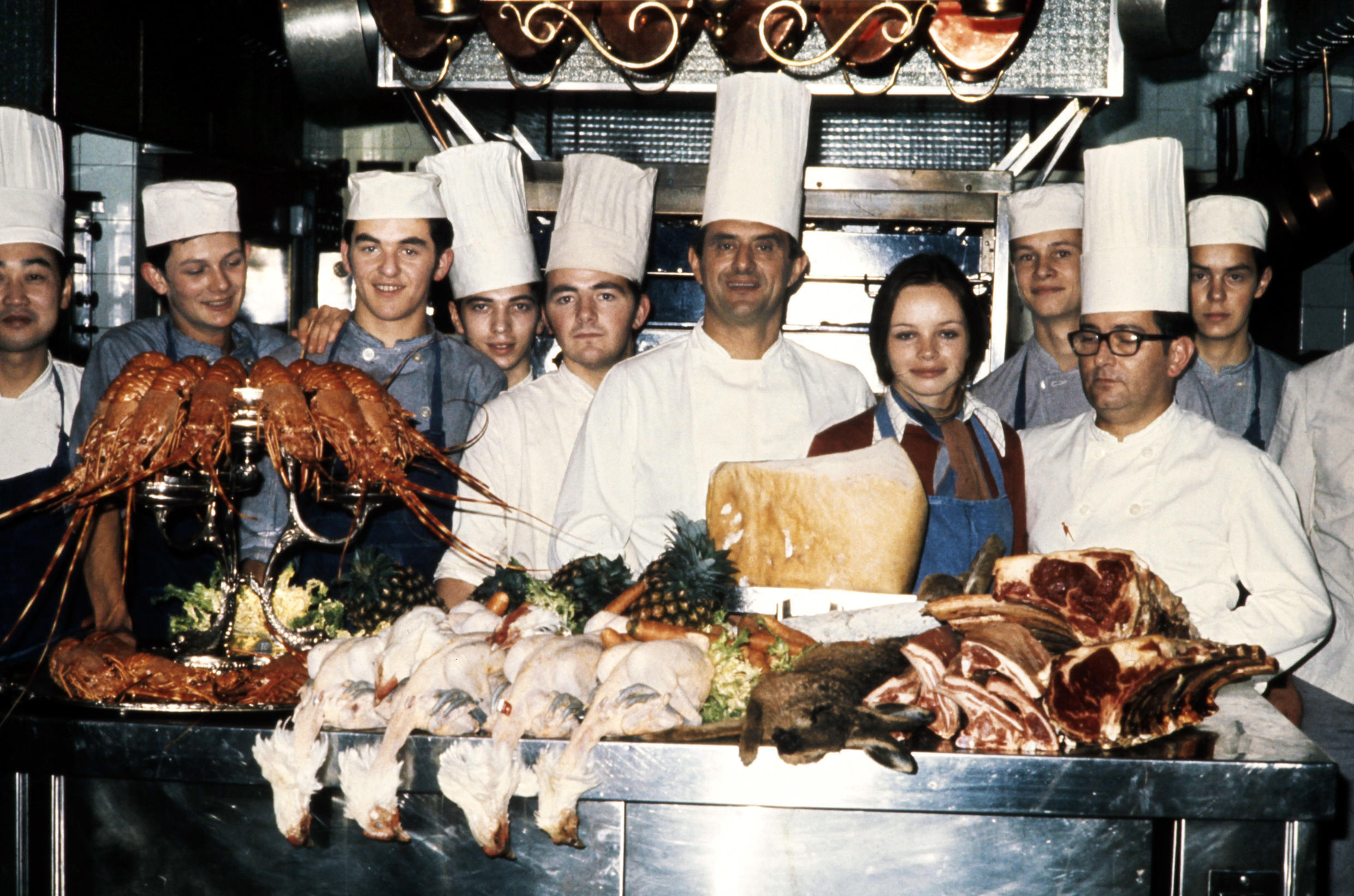 French restaurant Chef Paul Bocuse poses, on November 15, 1973 in his kitchen with his staff prior to prepare meals in Lyon.