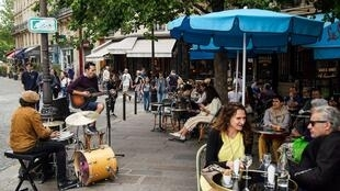 France eased lockdown further and staged its annual music festival on Sunday, with music returning to cafes and street corners