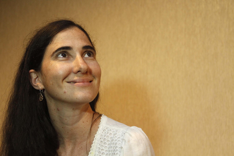 Yoani Sánchez a su llegada a Brasil en 2013