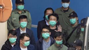 Sur les bancs des accusés, des avocats, des députés, des universitaires et de jeunes militants. Hong Kong, le 2 mars 2021.