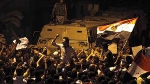 Demostrators outside Israel's embassy in Cairo on Friday night