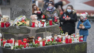 Candles in memory of pedestrians killed by driver in Trier_1 Dec 2020_Oliver Dietze dpa via AP