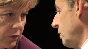 Angela Merkel e Nicolas Sarkozy divergem sobre papel do BCE na saída da crise na zona do euro.